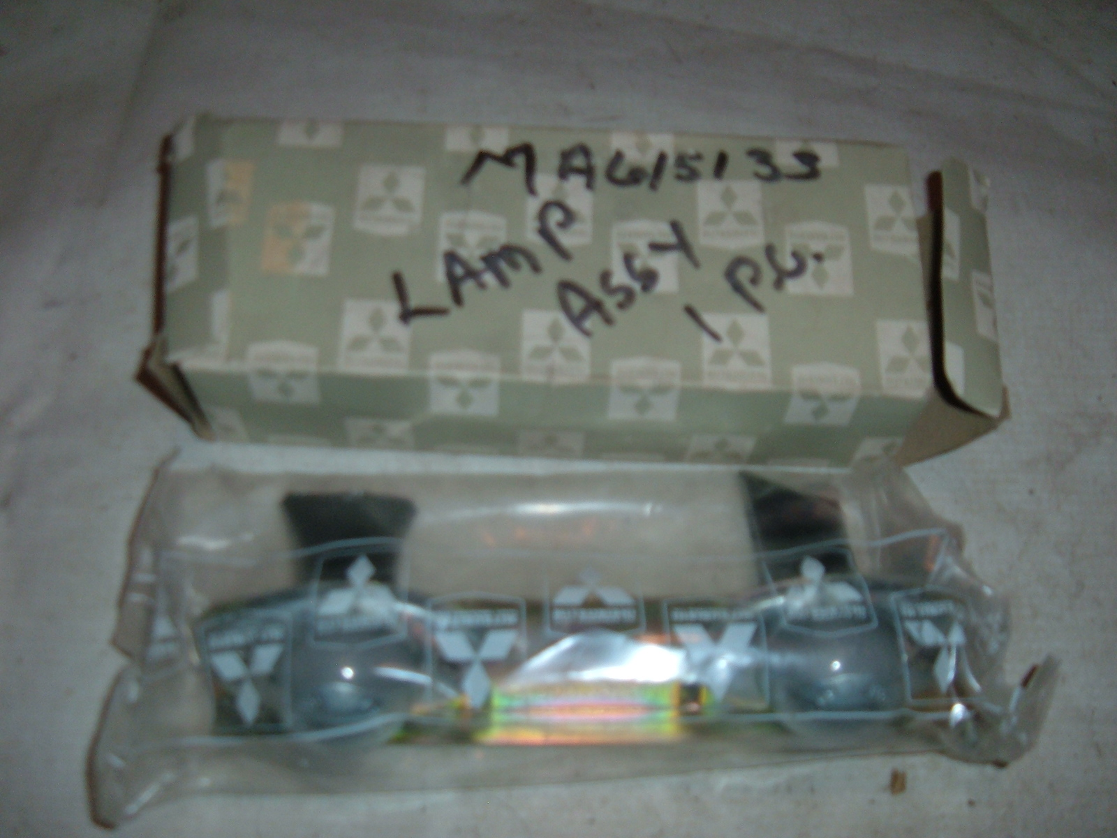View Product1971 72 73 dodge colt license plate light assembly nos mitsubishi MA6151331 MA-615133 (z ma615133)