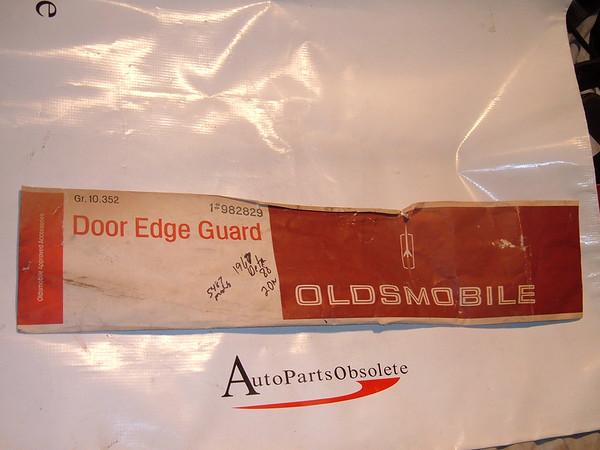 1967 oldsmobile delta 88 accessory door edge guards nos gm # 982829 (z 982829)