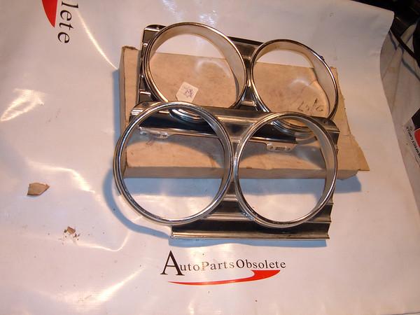 1966 chevrolet impala headlight bezel nos gm 3869747/48 (z 3869747/48)